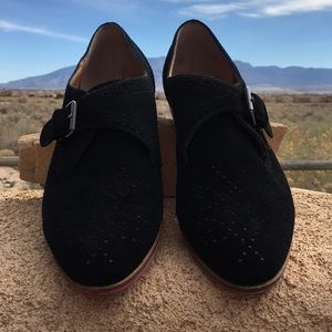 Black Dolce Vita perforated suede flat.